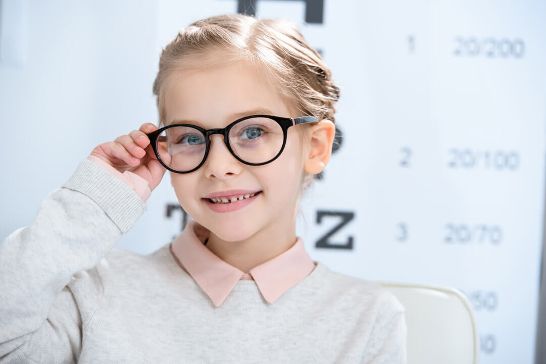 Child wearing glasses in a doctor's office
