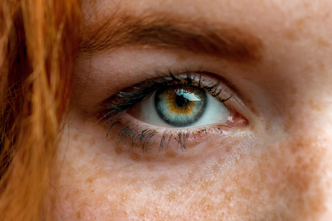 A close-up photo of a redheaded woman's eye