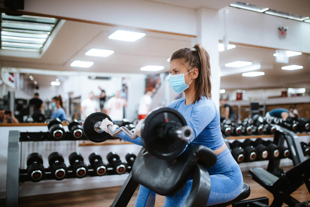 woman using weights in gym